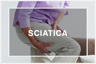 woman holding leg pain sciatica